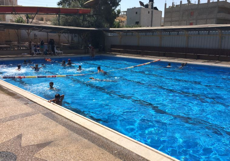 Swimming Pool Bank : The hunt for an olympic sized pool in west bank arab