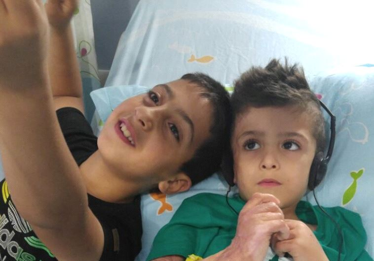 Ahmad Dawabsha at Shebaa Hospital with cousin