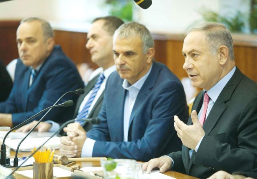 PRIME MINISTER Benjamin Netanyahu praises the new budget before the cabinet debate yesterday.