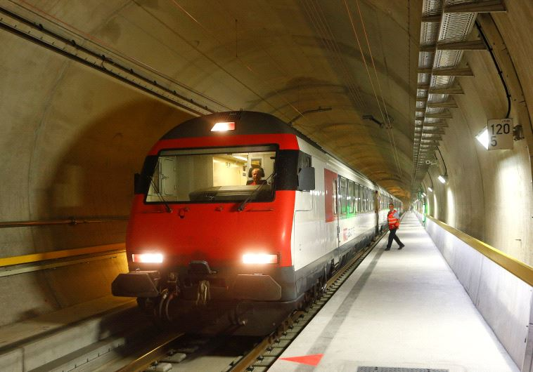 A train stands at the multifunction and emergency stop station of the NEAT Gotthard Base Tunnel, the