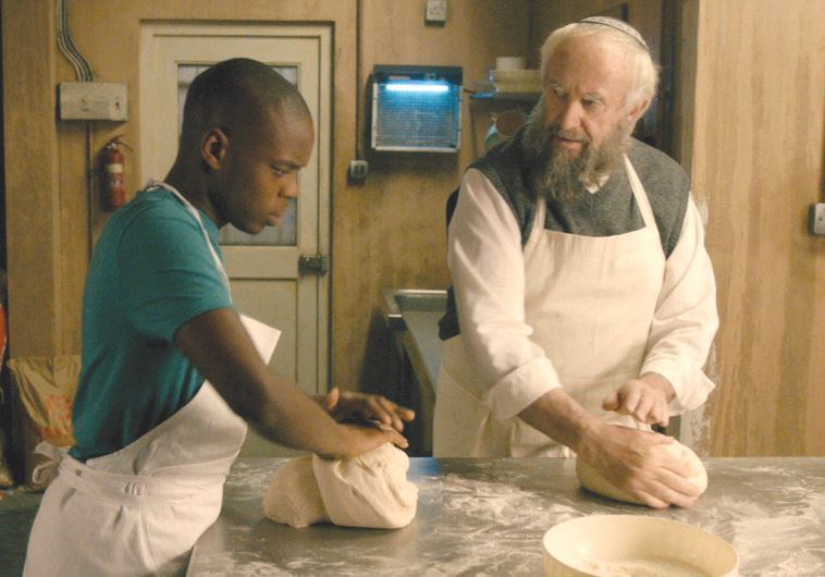 NAT AND Ayyash work in the bakery kitchen in 'Dough.'