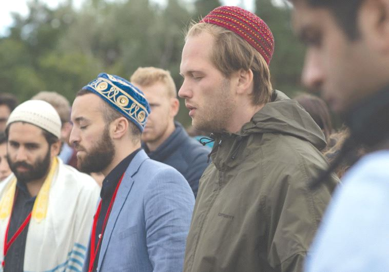 PARTICIPANTS IN THE Muslim Jewish Conference take part in interfaith prayer last week at the site of