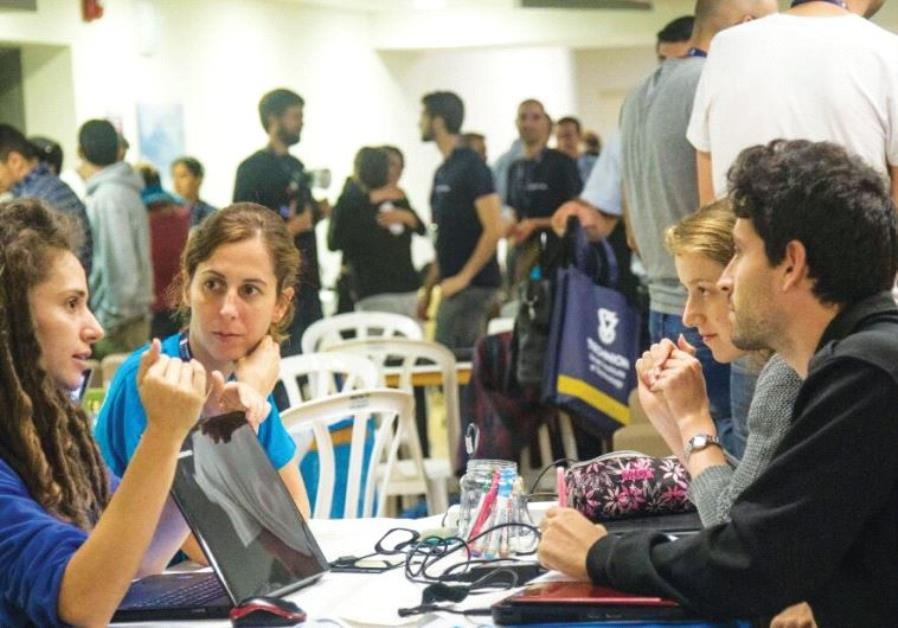 HACKATHONERS DISCUSS 'hasbara' ideas last week at the Technion