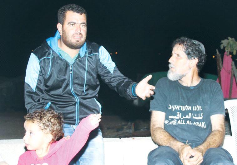VILLAGER NASSER NAWAJAA makes a point to human rights activist Rabbi Arik Ascherman in Sussiya yeste