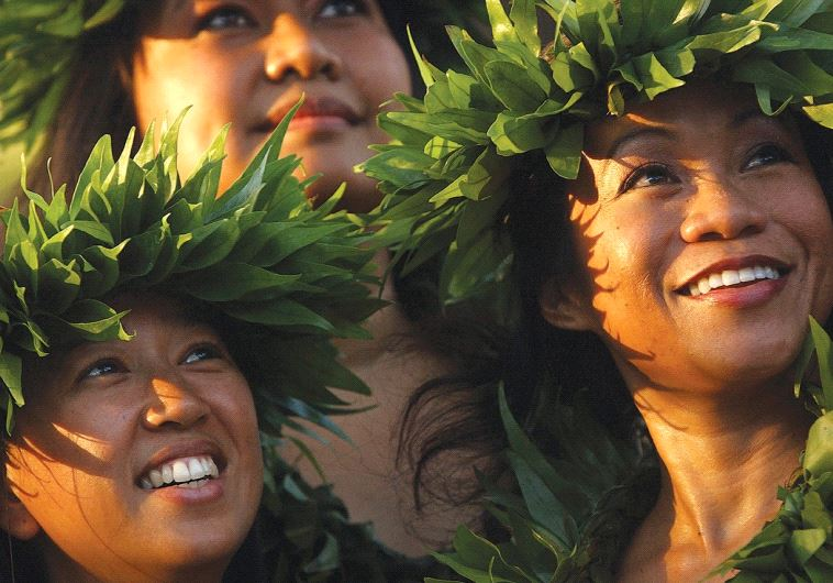 DANCERS PERFORMING at the Waikiki Shell on Waikiki Beach in Honolulu, Hawaii.