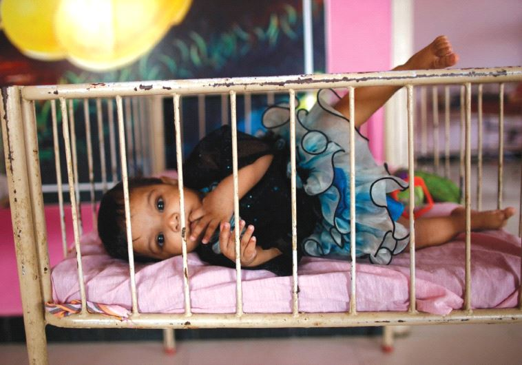 A BABY lies in her crib in this illustrative photo. (