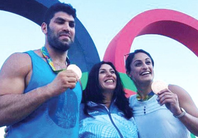 ISRAELI JUDKOAS Yarden Gerbi (right) and Ori Sasson (left), posing with Culture and Sport Minister M