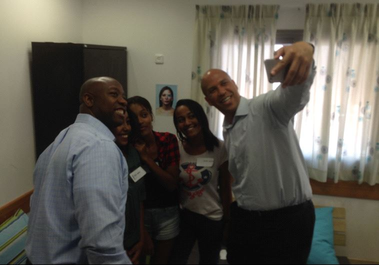 Senator Cory Booker and Tim Scott take a selfe with Ramla youth.