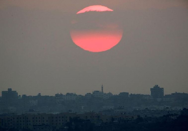 The sun sets over the northern Gaza Strip as seen from the Israeli border, Israel August 23, 2016