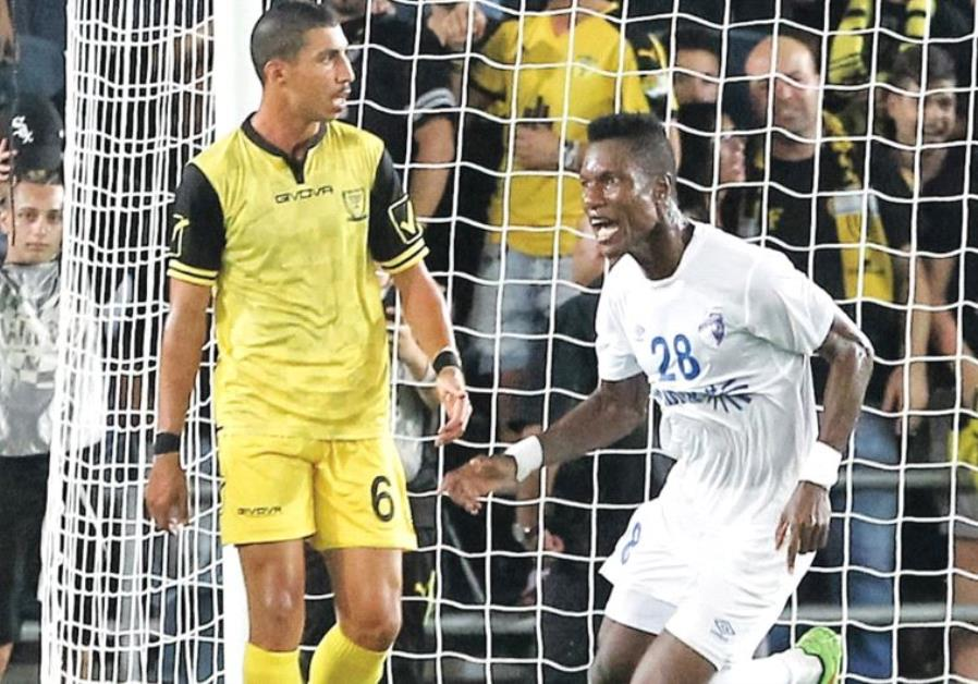 Ironi Kiryat Shmona midfielder Didier Brossou (right) celebrates after netting a 94th-minute equaliz