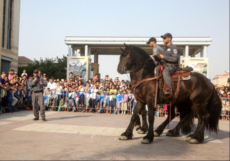 Police hold special exhibition for kids and parents in Jerusalem's Safra Square