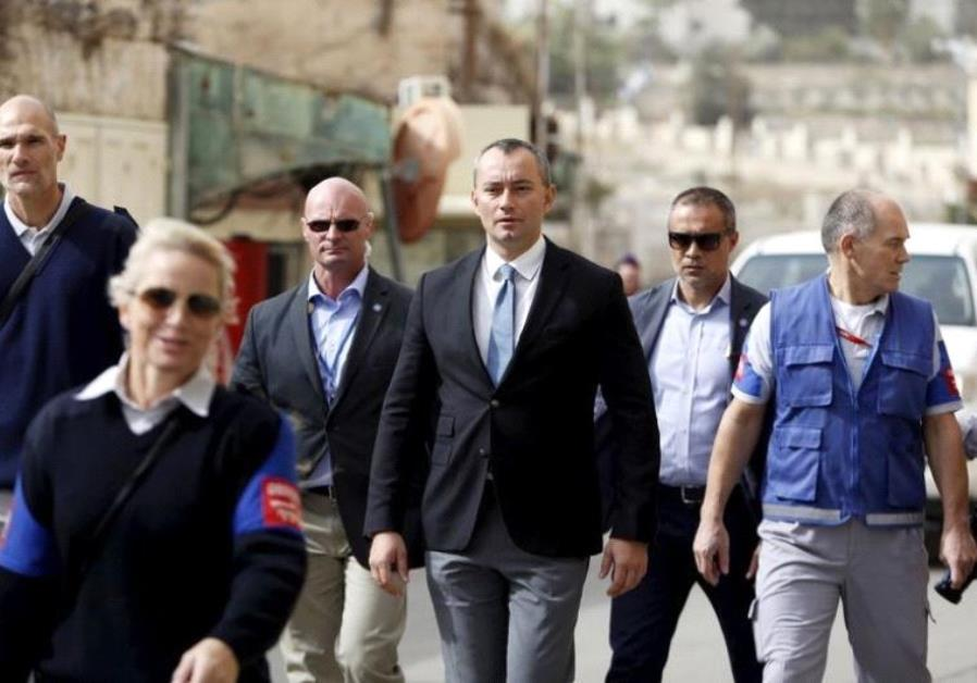 Nickolay Mladenov (C), the United Nations Secretary-General Special Representative to the Middle Eas