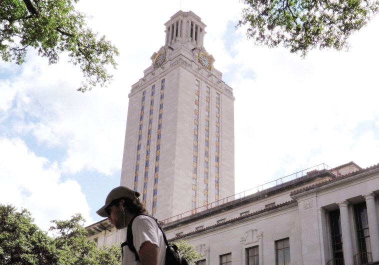 BACK TO school. A student walks at the University of Texas campus in Austin, Texas.