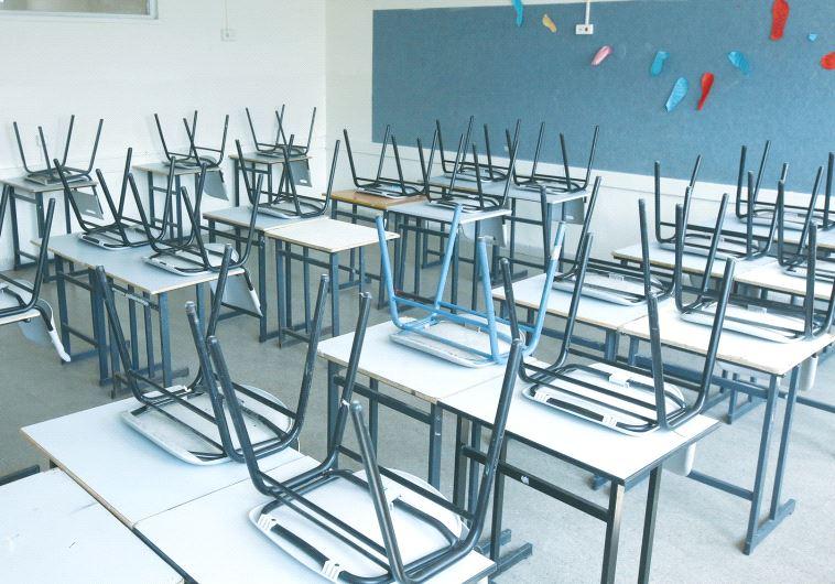 A CLASSROOM awaits its pupils.
