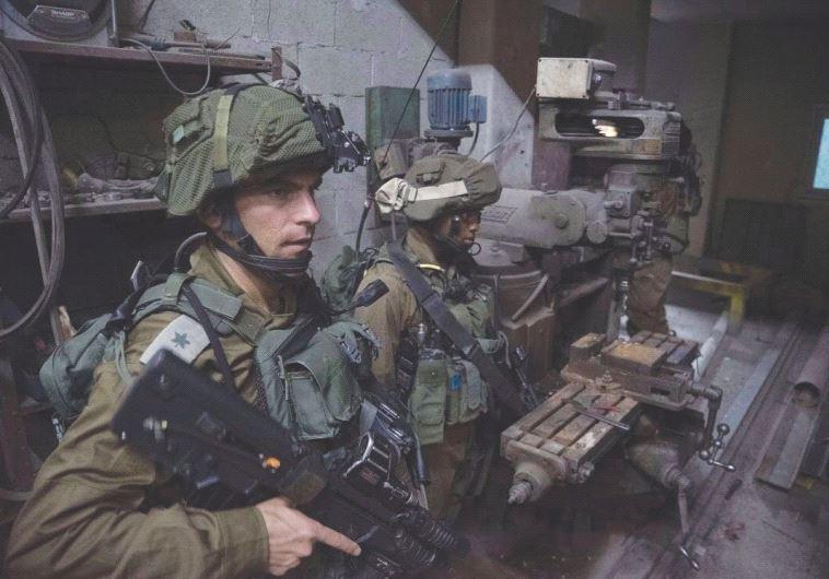 IDF TROOPS raid a West Bank weapons workshop this week.