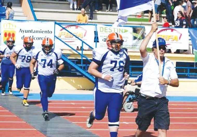 AMERICAN FOOTBALL IN ISRAEL president Steve Leibowitz leads the national tackle football team onto t
