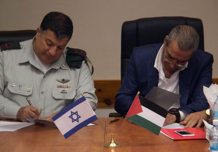 Yoav Mordechai and Hussein al-Sheikh.