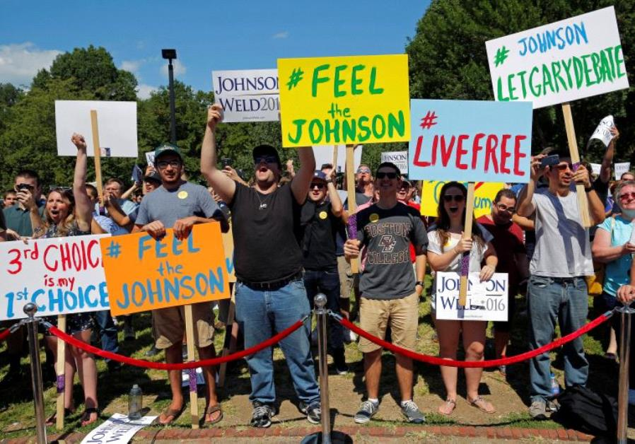 Supporters cheer at a campaign rally with Libertarian presidential candidate Gary Johnson and vice p