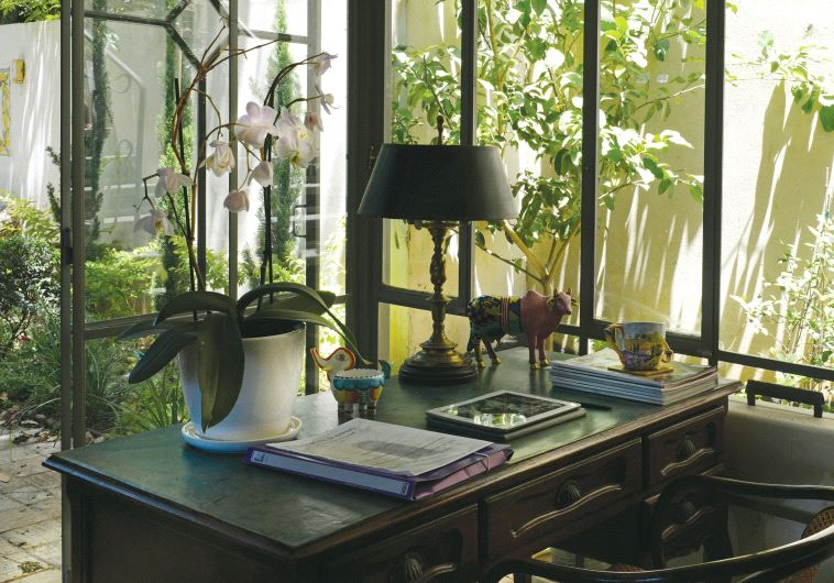 KIM LINDY'S antique mahogany desk in her home in Ramat Hasharon.