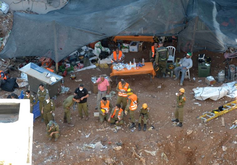RESCUE PERSONNEL work at the disaster site in northeastern Tel Aviv