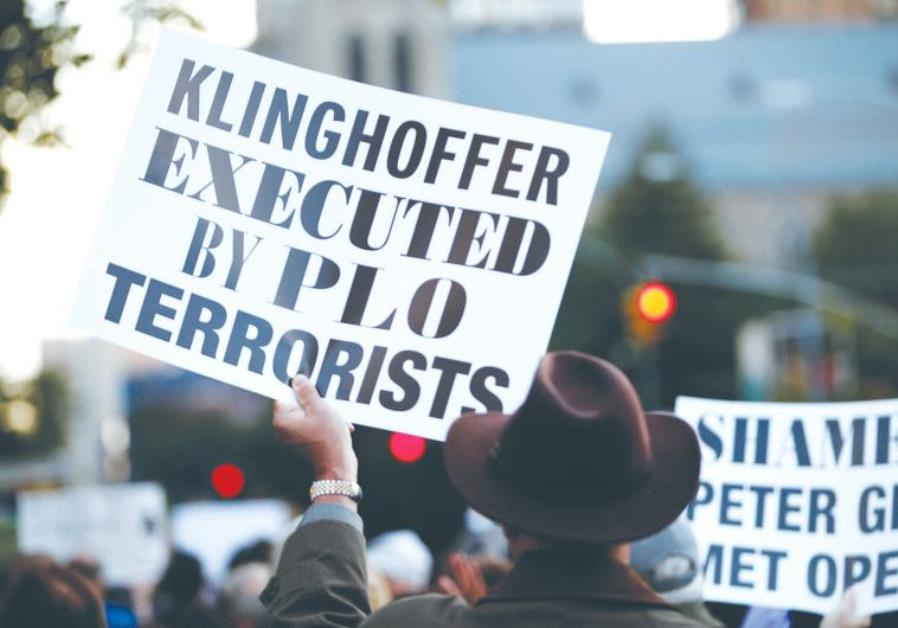 A PROTESTER holds up a sign condemning the Palestine Liberation Organization for the murder of Leon
