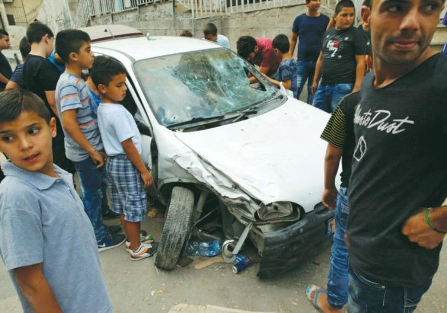 BORDER POLICE fired on this car in the capital's Shuafat refugee camp on September 5, killing the pa
