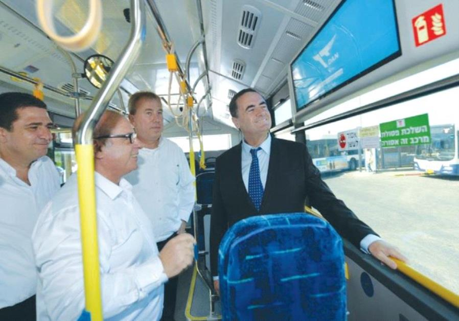 TRANSPORTATION MINISTER Israel Katz takes a ride yesterday in one of Tel Aviv's new Dan electric bus