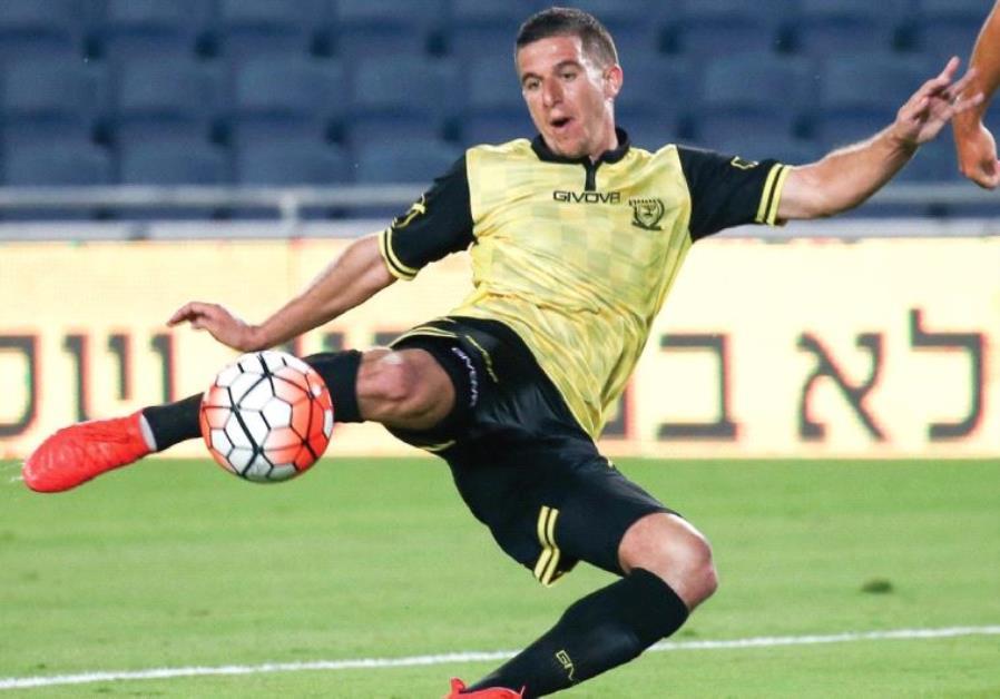 Beitar Jerusalem midfielder Idan Vered (left) scored his team's opener in last night's 3-0 win over