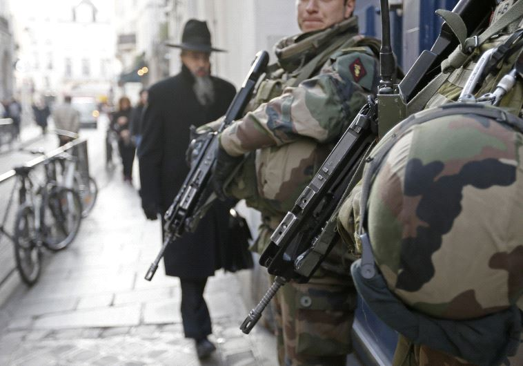 French soldiers patrol the street in a Jewish neighbourhood near a religious school and a synagogue