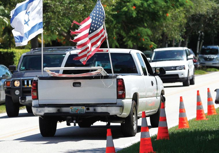 Israeli and American flags.