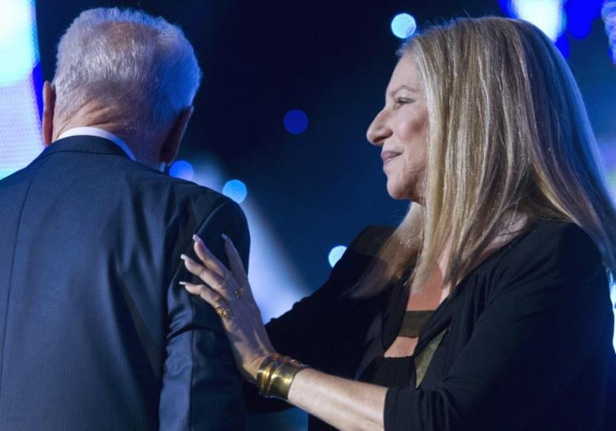 Shimon Peres with US singer Barbara Streisand after she sang at two songs durings Peres' 90th birthd
