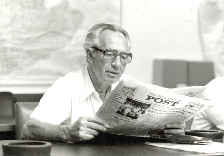 SHIMON PERES reads 'The Jerusalem Post' in January 1987.