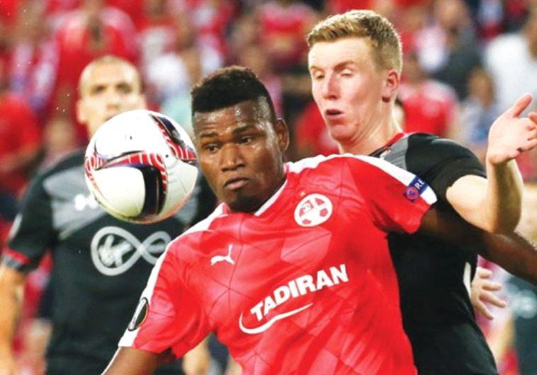 Hapoel Beersheba striker Lucio (front) battles Southampton's Matt Targett during last night's goalle
