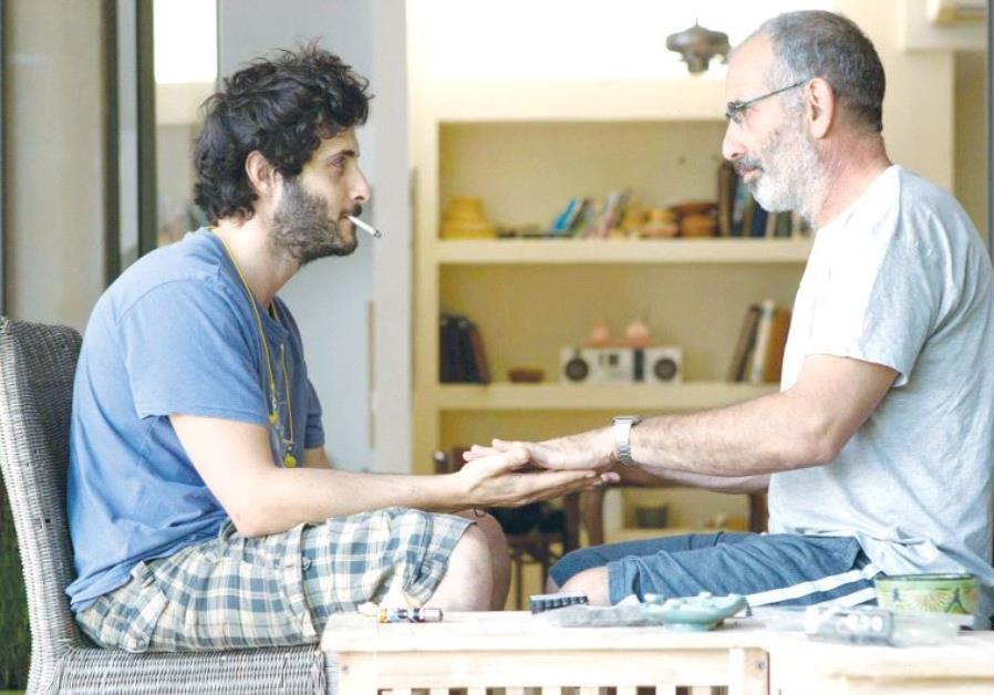TOMER KAPON (left) and Shai Avivi in a scene from 'One Week and a Day.'