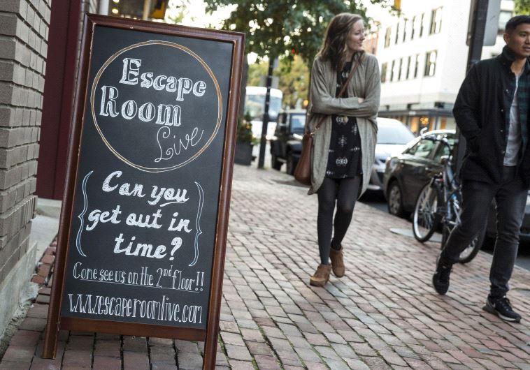 Pedestrians pass the Escape Room Live in Alexandria, Virginia Octobe