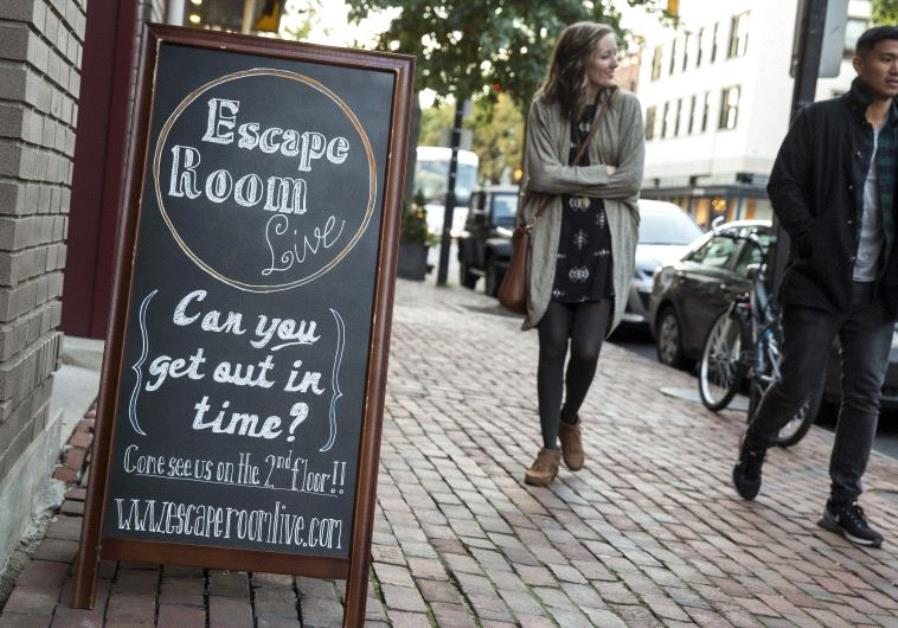 Pedestrians pass the Escape Room Live in Alexandria, Virginia Octobe