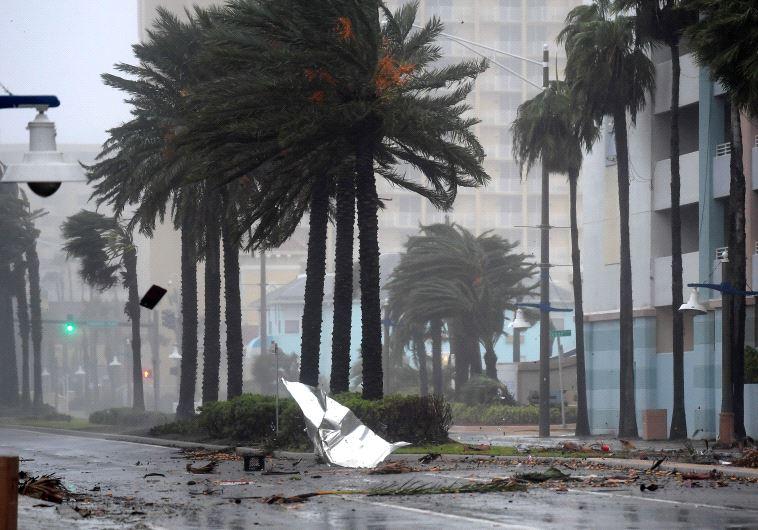 Debris flies through the air as the eye of Hurricane Matthew nears Daytona Beach, Florida