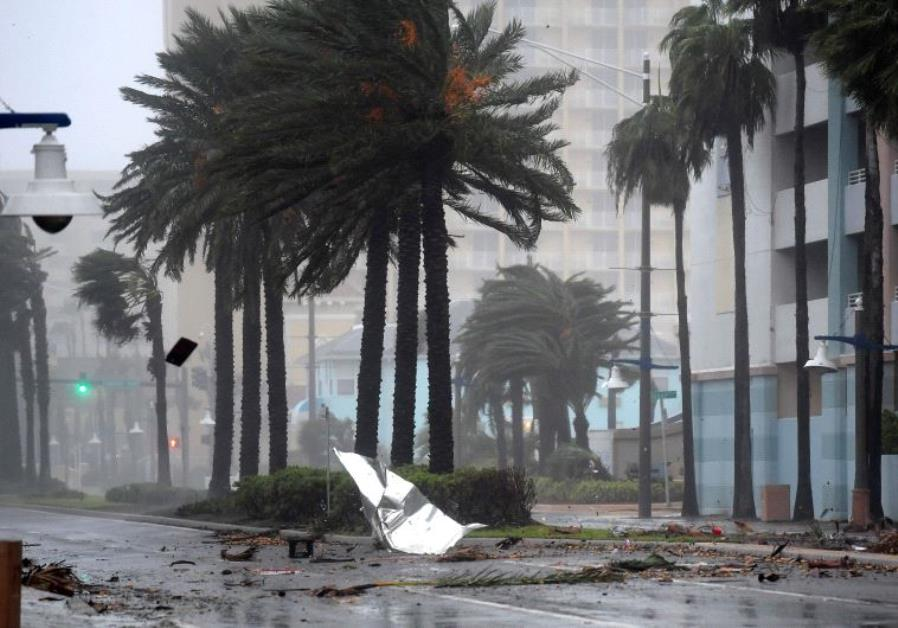 Debris flies through the air as the eye of Hurricane Matthew nears Daytona Beach, Florida