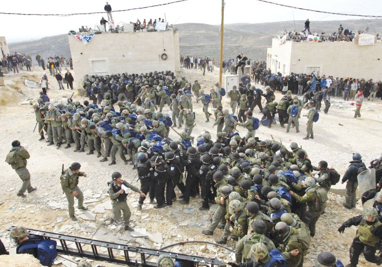 ISRAELI POLICEMEN gather in 2006 to remove the outpost of Amona.