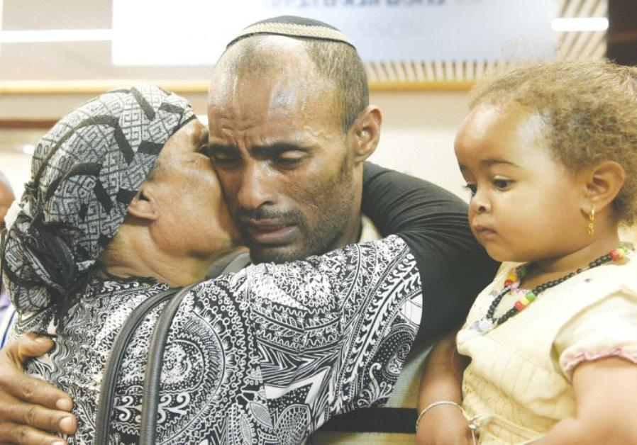 ETHIOPIAN IMMIGRANTS are greeted by loved ones at Ben-Gurion Airport.