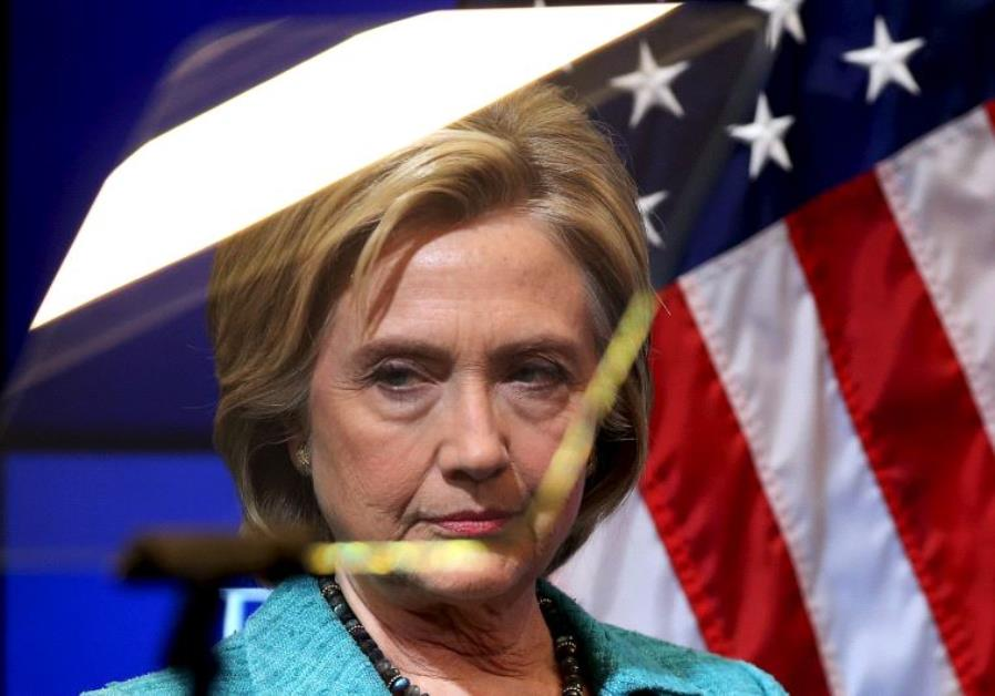 Democratic presidential candidate Hillary Clinton looks through a teleprompter before discussing the