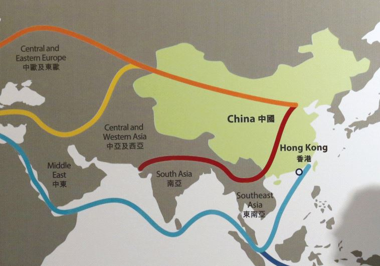 THE SHADOW of a participant is seen on a map illustrating China's 'One Belt, One Road' megaproject a