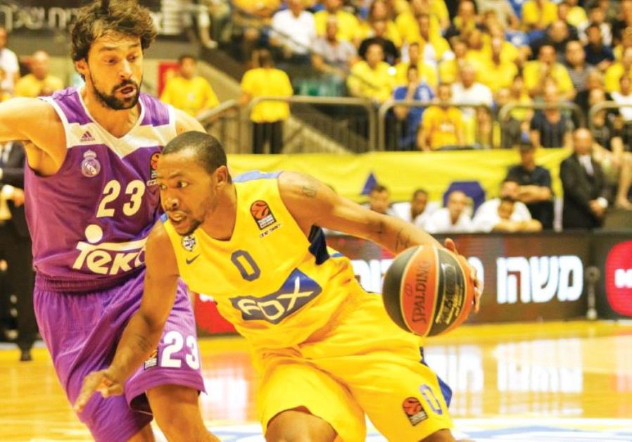 Maccabi Tel Aviv guard Andrew Goudelock (right) scored 16 points in last night's 89-82 defeat to Ser