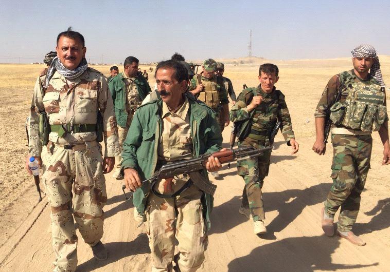 Kurdish peshmerga forces on the way to Mosul