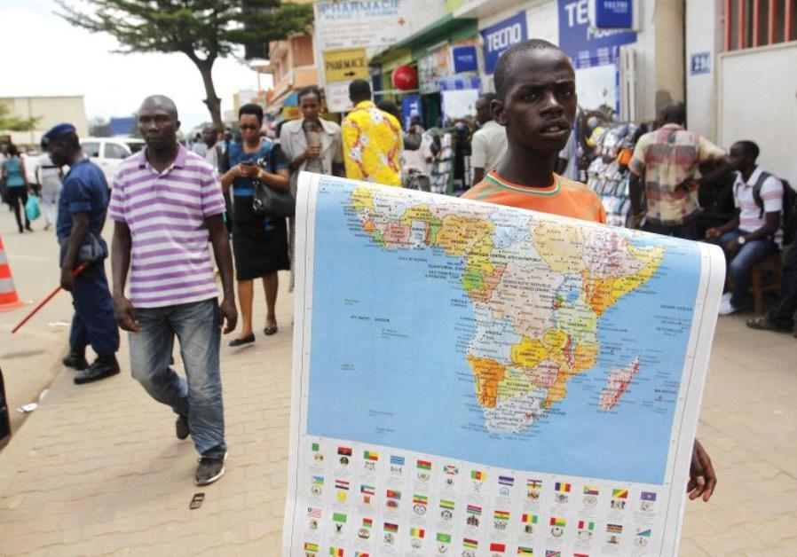 NEW FRIENDS everywhere for Israel. A vendor sells a map of Africa along the streets of Bujumbura, Bu