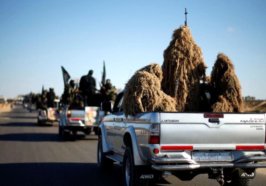 Arab militants parade in Rafah.