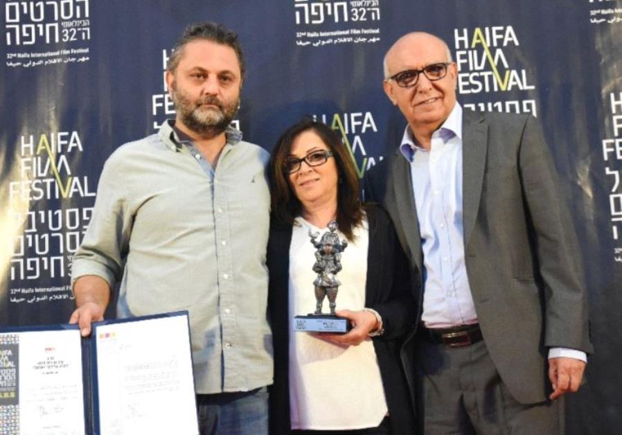 ACTORS MAHMOUD SHAWAHDEH (right) and Sana Shawahdeh pose with producer Baher Agbariya (left) after w