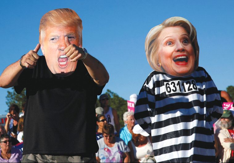 PEOPLE DRESS UP as US presidential nominees Donald Trump and Hillary Clinton at a Trump campaign ral