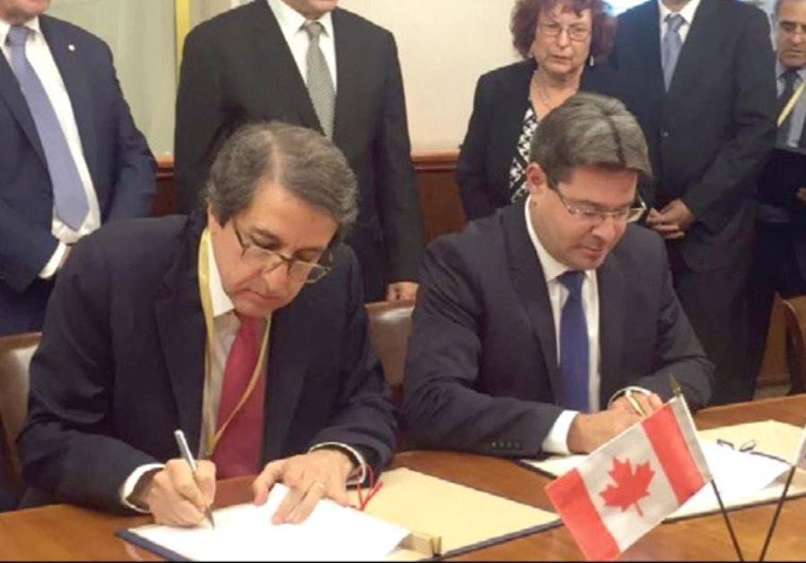SCIENCE, TECHNOLOGY and Space Minister Ofir Akunis (right) and Dr. Alejandro Adem sign the Canadian-