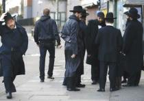 JEWISH MEN share a conversation in Golders Green, London, in January 2015.